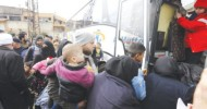 Syrian rebels, families begin leaving Homs district in deal with govt