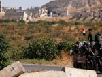 Syrian army deploy along Turkish border after deal with Kurdish-led forces