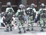 Hong Kong police arrest more than 50 in Tsim Sha Tsui near besieged PolyU