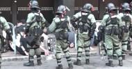 Hong Kong police arrest more than 50 in Tsim Sha Tsui near besieged PolyU