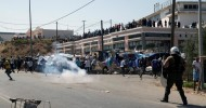 Greek police fire tear gas as refugees demand to leave Lesbos Chanting 'freedom', the former inhabitants of burned Moria camp protest against plan to be moved to another facility.