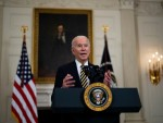 """Biden reverses Trump visa ban on legal immigration .""""It harms the United States,"""" Biden said of the ban."""
