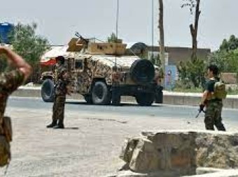 Afghan forces struggle against Taliban assaults on major cities