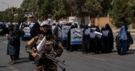 Women in full burqas march in support of Taliban in Afghanistan