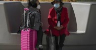 China bans flights, shut schools to stamp out new COVID-19 outbreak